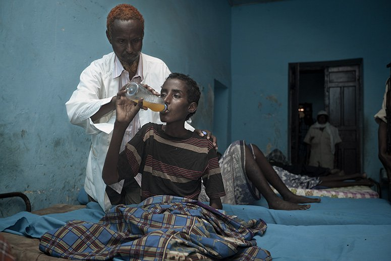 'Dr' Abdi Rahman Ali Alwa Habeeb treating an in-patient at the Habeeb Public Mental Health Clinic in Mogadishu, Somalia.